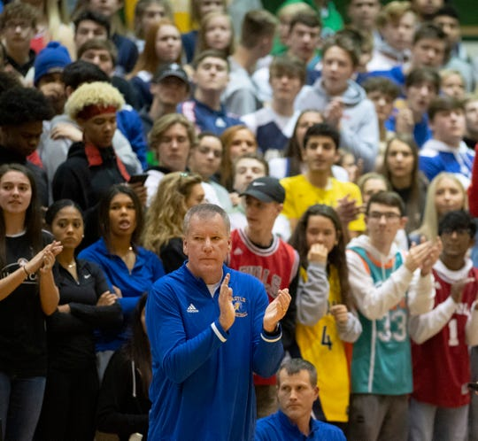 Castle Head Coach Brian Gibson applauds his team's effort against Reitz during the championship game of the IHSAA 4A Boys basketball sectional at North High School Saturday night, March 7, 2020.