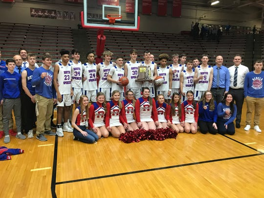 The South Spencer boys basketball team poses with the sectional championship trophy following Saturday's 56-55 victory over North Posey.