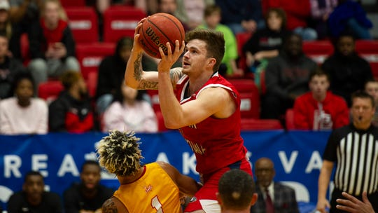 USI's Clayton Hughes goes up for a shot during Saturday's GLVC semifinal game against University of Missouri-St. Louis.