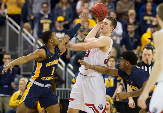 Belmont's Nick Muszynski (33) is forced to pass  as the Belmont Bruins play the Murray State Racers during the Ohio Valley Conference Championship game at Ford Center Saturday evening, March 7, 2020.