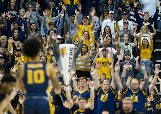 Murray State fans hold up their hands as Murray State's Tevin Brown (10) shots one from the line during the Ohio Valley Conference Championship game at Ford Center Saturday evening, March 7, 2020.
