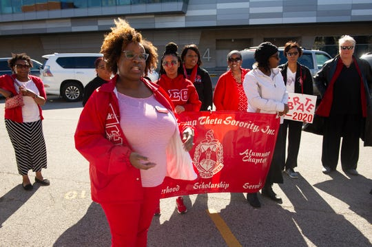 Lori Sutton, president of the Evansville Alumnae Chapter (EAC) of Delta Sigma Theta Sorority addresses the crowd before the commemorative Women's Suffrage March at the Civic Center Sunday afternoon, March 8, 2020.