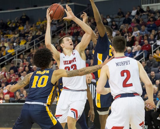 Belmont's Nick Muszynski (33) takes a shot under pressure  as the Belmont Bruins play the Murray State Racers during the Ohio Valley Conference Championship game at Ford Center Saturday evening, March 7, 2020.