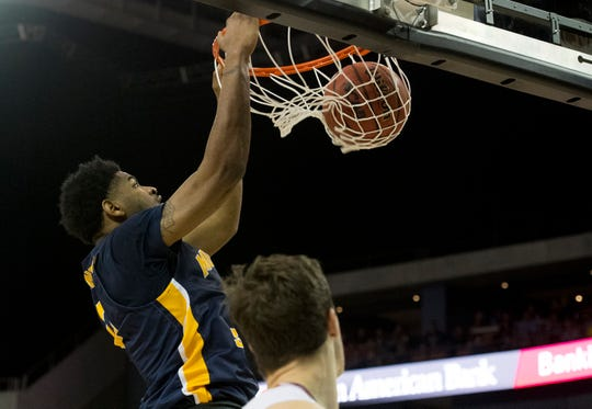 Murray State's Demond Robinson (0) dunks the ball as the Murray State Racers play the Belmont Bruins during the Ohio Valley Conference Championship game at Ford Center Saturday evening, March 7, 2020.