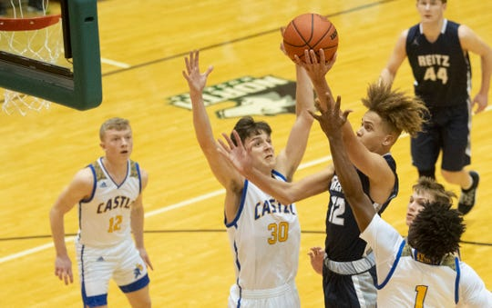 Reitz's Owen Dease (12) drives the paint for two of his 14 first-half points against Castle during the championship game of the IHSAA 4A Boys basketball sectional at North High School Saturday night, March 7, 2020.