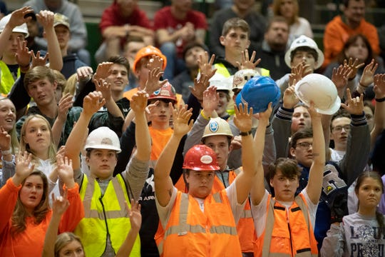 The Reitz student section offers their sideline mojo for their player's free throws against Castle during the championship game of the IHSAA 4A Boys basketball sectional at North High School Saturday night, March 7, 2020.
