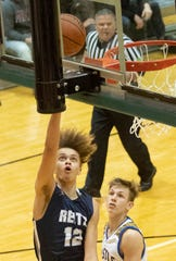 Reitz's Owen Dease (12) lays in a bucket for two of his two first-half points against Castle during the championship game of the IHSAA 4A Boys basketball sectional at North High School Saturday night, March 7, 2020.