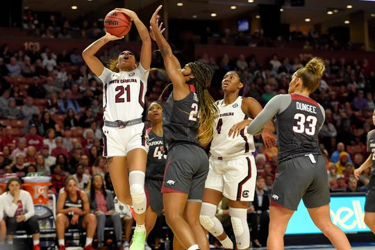 South Carolina's Mikiah Herbert-Harrigan (21) shoots while defended by Arkansas' Taylah Thomas (24) during a semifinal match at the Southeastern conference women's NCAA college basketball tournament in Greenville, S.C., Saturday, March 7, 2020. (AP Photo/Richard Shiro)
