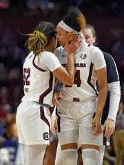 South Carolina's Tyasha Harris, left, embraces LeLe Grissett, right, during a championship match against Mississippi State at the Southeastern conference women's NCAA college basketball tournament in Greenville, S.C., Sunday, March 8, 2020. (AP Photo/Richard Shiro)