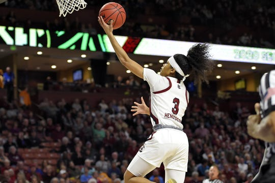 South Carolina's Destanni Henderson (3) drives to the basket during a semifinal match against Arkansas at the Southeastern conference women's NCAA college basketball tournament in Greenville, S.C., Saturday, March 7, 2020. (AP Photo/Richard Shiro)