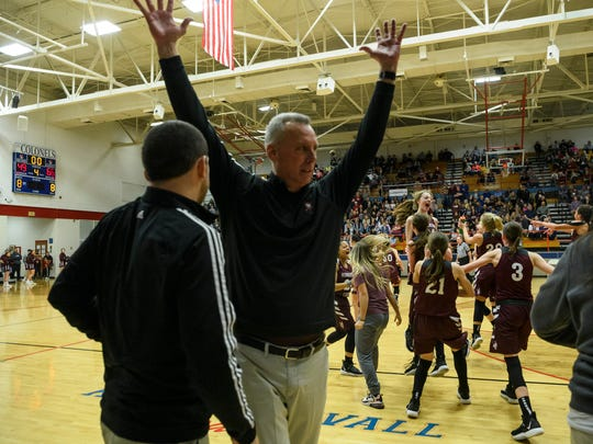 Henderson County Head Coach Jeff Haile celebrates on the side as the Lady Colonels rush the court to celebrate their second region championship win over the Madisonville-North Hopkins Lady Maroons at Christian County High School in Hopkinsville, Ky., Saturday, March 7, 2020. The Lady Colonels defeated the Lady Maroons, 66-49.