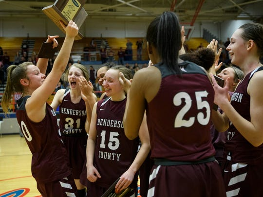 The Henderson County Lady Colonels celebrate their second region championship win over the Madisonville-North Hopkins Lady Maroons at Christian County High School in Hopkinsville, Ky., Saturday, March 7, 2020. The Lady Colonels defeated the Lady Maroons, 66-49.