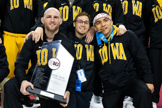 From left: Alex Marinelli, Spencer Lee and Pat Lugo celebrate after winning individual titles at the Big 10 Wrestling Championships March 8, 2020; Piscataway, NJ, USA.