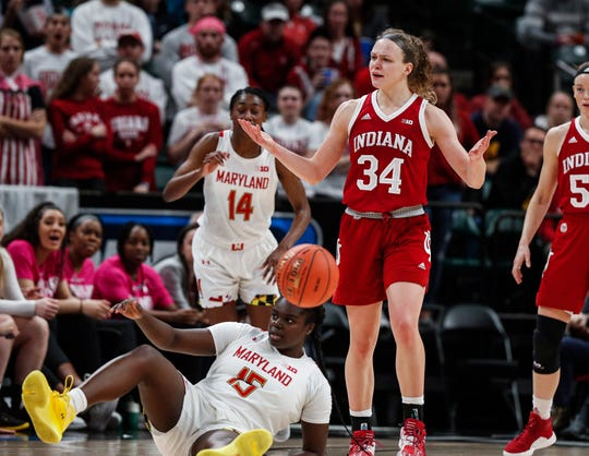 Indiana Hoosiers guard Grace Berger (34) reacts to a call after attempting to steal the ball from Maryland Terrapins guard Ashley Owusu (15) during the Big Ten Semifinals at Bankers Life Fieldhouse, Indianapolis, Saturday, March 7, 2020. Maryland Terrapins up, 28-24.