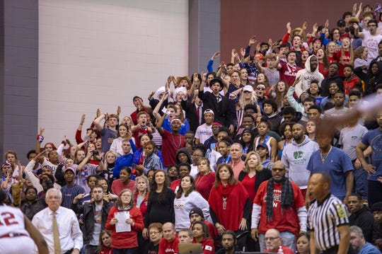 Lawrence North High School fans cheer during the second half of action in an IHSAA boys' sectional championship basketball game against Warren Central High School, Saturday, March 7, 2020, at Lawrence Central High School. Lawrence North won 61-59.