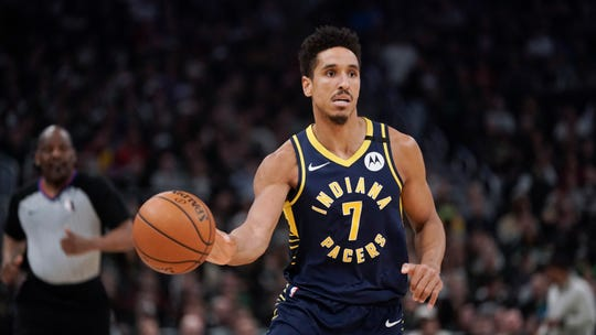 Indiana Pacers' Malcolm Brogdon dribbles during the second half of an NBA basketball game against the Milwaukee Bucks Wednesday, March 4, 2020, in Milwaukee. The Bucks won 119-100.
