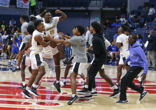 Starkville players celebrate after winning the MHSAA 6A basketball championship over Murrah on Saturday, March 7, 2020 at The Pavilion at Ole Miss. Photo by Keith Warren