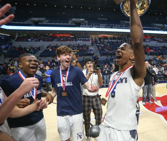 St. Andrew's's Rashad Bolden (5) raises the MHSAA Class 3A basketball championship trophy in the air following the win over Velma Jackson on Saturday, March 7, 2020, at The Pavilion at Ole Miss.