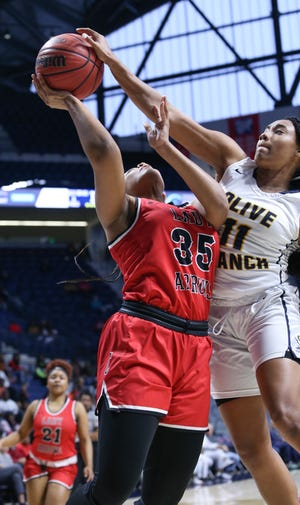 Olive Branch's Nadia Gillespie blocks the shot attempt by Clinton's Kaitlyn Walker (35) in the first quarter of the MHSAA 6A girls basketball championship game on Saturday, March 7, 2020, at The Pavilion at Ole Miss.