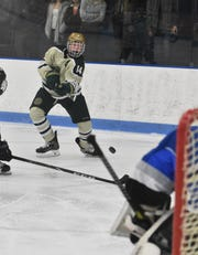 Howell's Stefan Frantti, who had a goal and three assists, fires a shot in a 4-3 victory over Macomb L'Anse Creuse North in a state Division 1 hockey quarterfinal on Saturday, March 7, 2020.