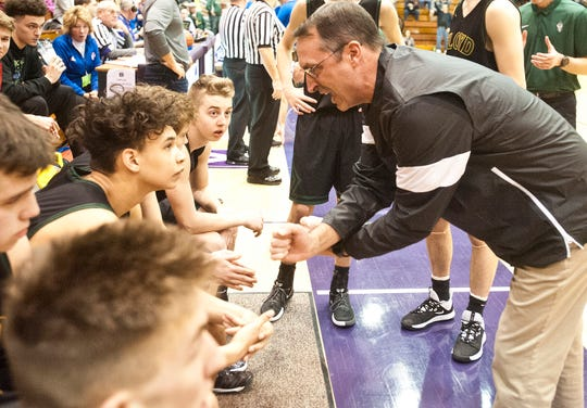 Floyd Central head basketball coach Todd Sturgeon talks to his players before the start of the IHSAA Seymour Sectional Boys Basketball championship game.March 05,  2020