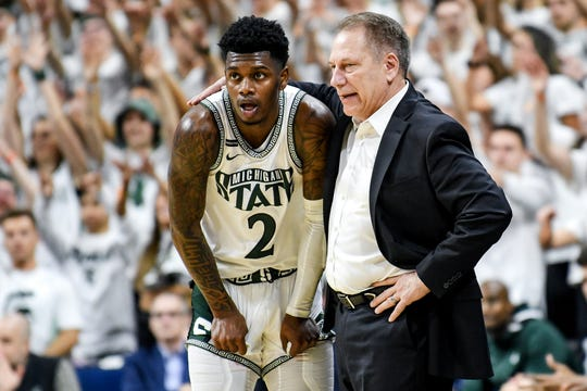 Michigan State's head coach Tom Izzo, right, talks with Rocket Watts during the first half on Sunday, March 8, 2020, at the Breslin Center in East Lansing.