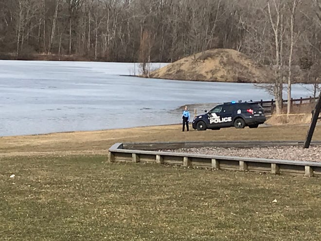 Emergency crews pulled a person from the lake at Hawk Island Park Sunday, March 8, 2020.