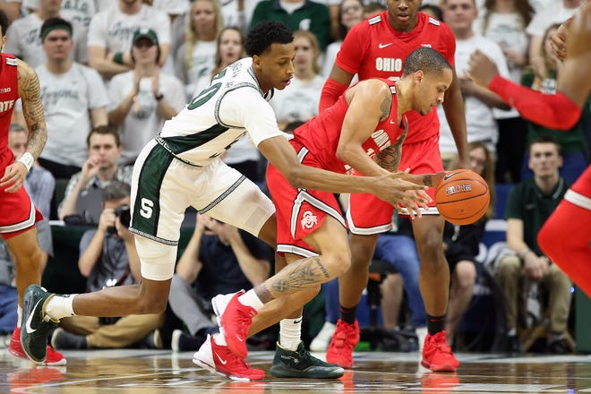 Michigan State's Marcus Bingham Jr. knocks the ball away from Ohio State's Duane Washington Jr. during last year's meeting on March 8 in East Lansing. That turned out to be MSU's final game of last season.