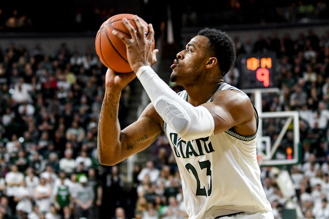 Michigan State's Xavier Tillman makes a shot during the first half on Sunday, March 8, 2020, at the Breslin Center in East Lansing.