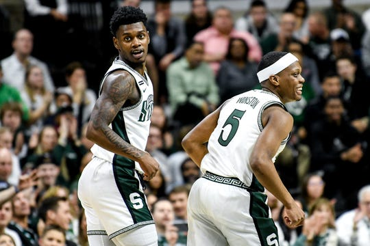 Michigan State's Rocket Watts, left, celebrates with Cassius Winston after Watts' 3-pointer during the first half on Sunday, March 8, 2020, at the Breslin Center in East Lansing.