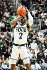 Michigan State's Rocket Watts makes a 3-pointer during the first half on Sunday, March 8, 2020, at the Breslin Center in East Lansing.