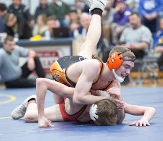 Case George won the 120 pound title at the Division II district meet to lead four state qualifiers for Ashland.