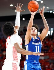Memphis Tigers guard Lester Quinones makes a 3-pointer over Houston Cougars guard Nate Hinton during their game at the Fertitta Center on Sunday, March 8, 2020.