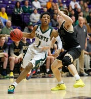 Briarcrest's Kennedy Chandler (1) pushes past Knoxville Catholic's Samuel Sompayrac (2) on Saturday, March 7, 2020, during the TSSAA Division II Class AA Boys State Basketball Championship game at Lipscomb University's Allen Arena in Nashville.