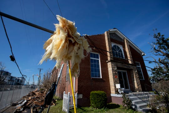 Insulation hangs from utility lines Sunday, March 8, 2020, in front of Mount Bethel Missionary Baptist Church in Nashville.