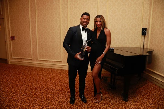 Russell Wilson and his wife, Ciara, March 7 at the Pfister Hotel for the Award of Excellence.