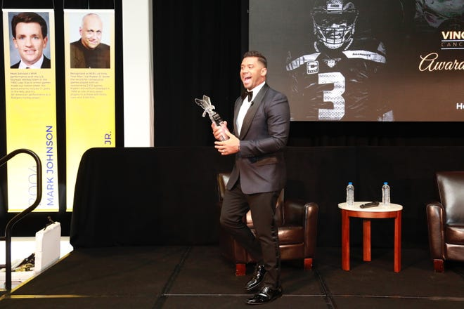 Russell Wilson accepts Award of Excellence from the Vince Lombardi Cancer Foundation in Milwaukee.