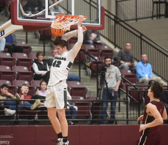 Izard County's Justus Cooper opens the second half with a slam dunk against Kirby on Saturday night.