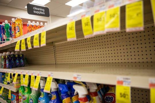Shelves where disinfectant wipes and sprays are usually displayed sit empty in a pharmacy in Providence, R.I., on March 4. Legions of nervous hoarders are stocking up on canned goods, frozen dinners, toilet paper, and cleaning products.