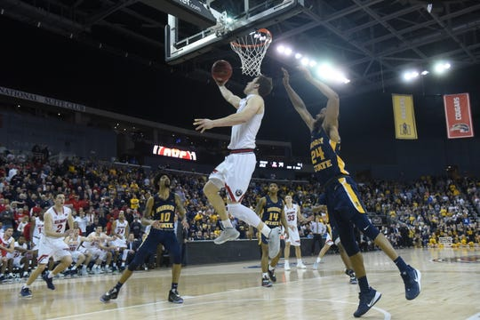Belmont's Tyler Scanlon scores the winning basket against Murray State in the OVC Tournament championship game Saturday night at Ford Center in Evansville, Indiana.