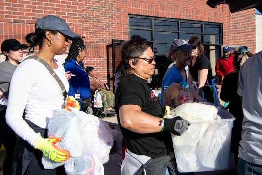 Volunteers work to distribute supplies for North Nashville victims of the tornado, organized by The Equity Alliance, at the Lee Chapel African Methodist Episcopal Church on Sunday, March 8, 2020 in Nashville, Tenn.