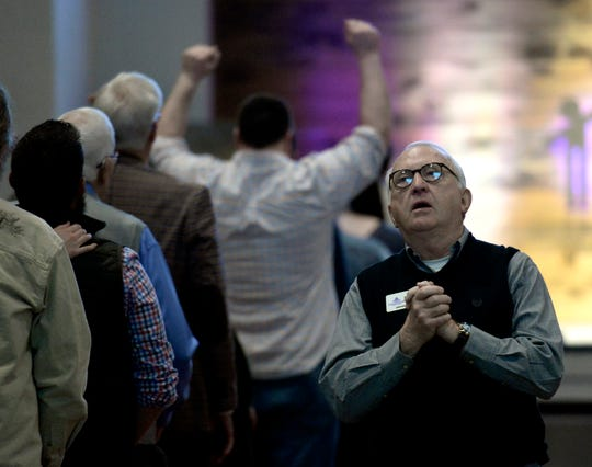 Parishioners pray for victims of the destructive tornados that ripped through Putnam County last Tuesday during a church service at Collegeside Church of Christ on Sunday, March 8, 2020, in Cookeville, Tenn.