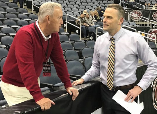 Retired Belmont coach Rick Byrd talks with Murray State coach Matt McMahon before the OVC Tournament championship game Saturday at Ford Center in Evansville, Indiana.