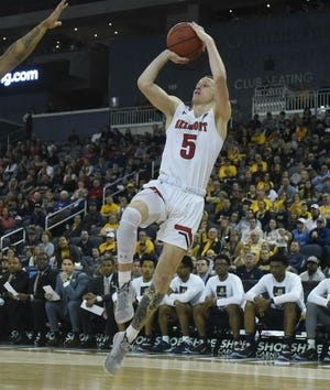 Belmont's Adam Kunkel takes a shot against Murray State in the Ohio Valley Conference Tournament championship Saturday night at Ford Center in Evansville, Indiana.