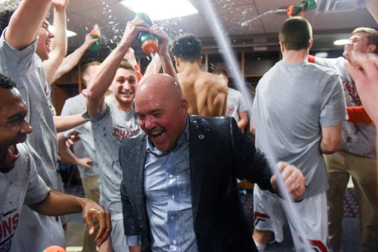 Belmont coach Casey Alexander celebrates with his players in the locker room after beating Murray State on Saturday in the OVC Tournament championship game at Ford Center in Evansville, Indiana.