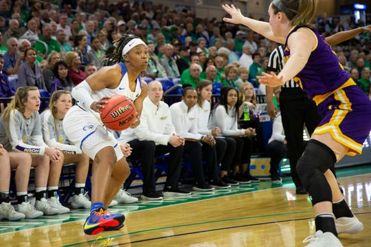 FGCU's Keri Jewett-Giles looks for a pass during an ASUN Tournament quarterfinal game against Lipscomb University at FGCU in Estero on Saturday, March 7, 2020. FGCU beat Lipscomb 105 to 71.