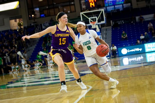 FGCU's Davion Wingate drives toward the basket during an ASUN Tournament quarterfinal game against Lipscomb University at FGCU in Estero on Saturday, March 7, 2020. FGCU beat Lipscomb 105 to 71.