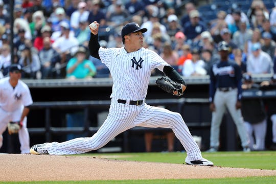 Mar 8, 2020; Tampa, Florida, USA;  New York Yankees starting pitcher Masahiro Tanaka (19) throws a pitch during the first inning against the New York Yankees at George M. Steinbrenner Field. Mandatory Credit: Kim Klement-USA TODAY Sports