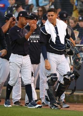 Mar 6, 2020; Tampa, Florida, USA; New York Yankees starting pitcher Deivi Garcia (left) walks to the dugout with catcher Gary Sanchez (24) before a game against the Baltimore Orioles  at George M. Steinbrenner Field. Mandatory Credit: Kim Klement-USA TODAY Sports