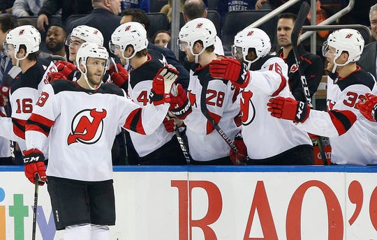 New Jersey Devils defenseman Fredrik Claesson (33) is congratulated after scoring a goal against the New York Rangers during the second period at Madison Square Garden.